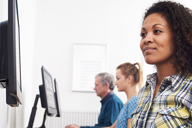 Woman researching why she should choose Compass Career College