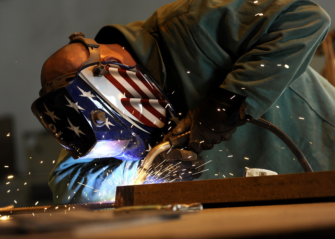 Welder with American flag faceguard working